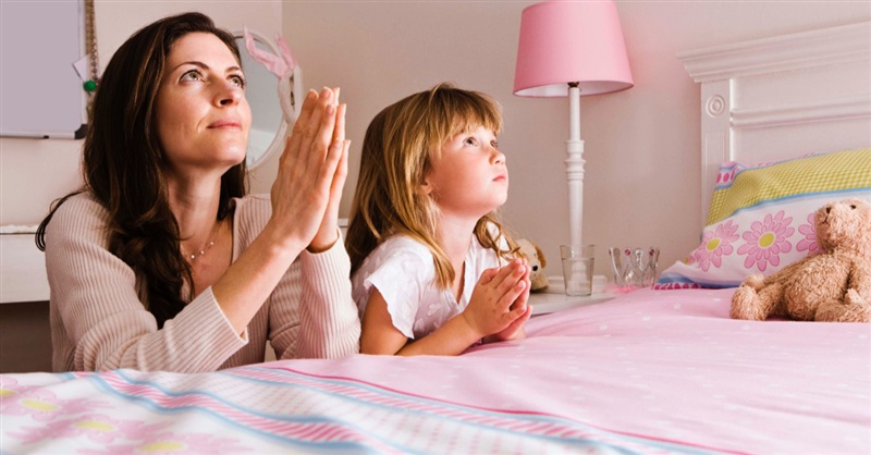 Praying Mom And Daughter